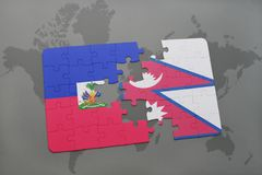 Puzzle with the national flag of haiti and nepal on a world map Stock Photography