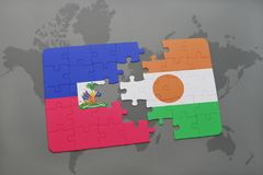 Puzzle with the national flag of haiti and niger on a world map Royalty Free Stock Photography