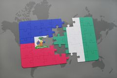 Puzzle with the national flag of haiti and nigeria on a world map Royalty Free Stock Photography