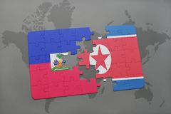 Puzzle with the national flag of haiti and north korea on a world map Stock Image