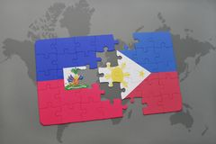 Puzzle with the national flag of haiti and philippines on a world map Royalty Free Stock Image