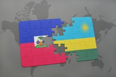 Puzzle with the national flag of haiti and rwanda on a world map Royalty Free Stock Image
