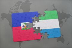 Puzzle with the national flag of haiti and sierra leone on a world map Royalty Free Stock Photography