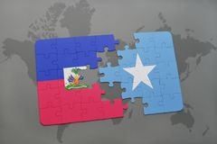 Puzzle with the national flag of haiti and somalia on a world map Royalty Free Stock Image
