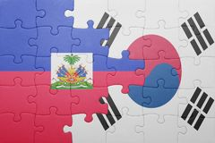 Puzzle with the national flag of haiti and south korea. Concept stock images