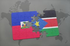Puzzle with the national flag of haiti and south sudan on a world map Stock Image