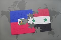 Puzzle with the national flag of haiti and syria on a world map Stock Photos