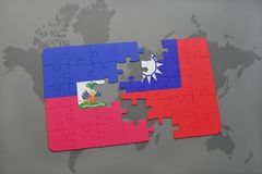 Puzzle with the national flag of haiti and taiwan on a world map Stock Photos