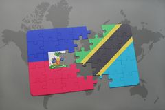 Puzzle with the national flag of haiti and tanzania on a world map Royalty Free Stock Images