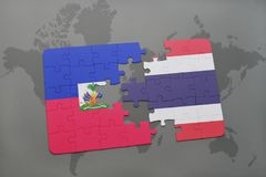 Puzzle with the national flag of haiti and thailand on a world map Stock Image