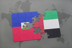 Puzzle with the national flag of haiti and united arab emirates on a world map Stock Photos