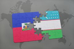 Puzzle with the national flag of haiti and uzbekistan on a world map Stock Photography