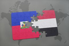 Puzzle with the national flag of haiti and yemen on a world map Royalty Free Stock Image