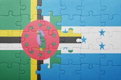 Puzzle with the national flag of honduras and dominica. Concept stock image