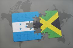 Puzzle with the national flag of honduras and jamaica on a world map background. 3D illustration stock photography