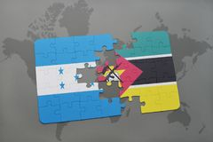 Puzzle with the national flag of honduras and mozambique on a world map. Background. 3D illustration Royalty Free Stock Image