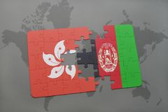 Puzzle with the national flag of hong kong and afghanistan on a world map background. 3D illustration Stock Photo