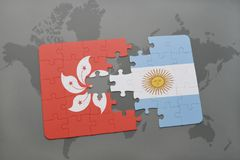 Puzzle with the national flag of hong kong and argentina on a world map background. Royalty Free Stock Image