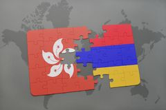 Puzzle with the national flag of hong kong and armenia on a world map background. Stock Photography