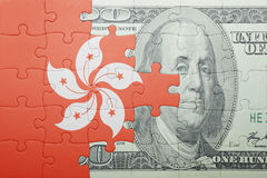 Puzzle with the national flag of hong kong and dollar banknote Stock Images