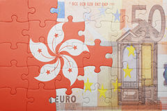 Puzzle with the national flag of hong kong and euro banknote. Concept Stock Images