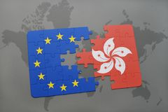 Puzzle with the national flag of hong kong and european union on a world map background. Concept Royalty Free Stock Photo