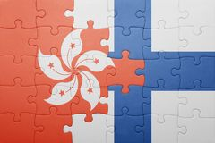 Puzzle with the national flag of hong kong and finland. Concept Royalty Free Stock Photos