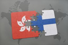 Puzzle with the national flag of hong kong and finland on a world map background. 3D illustration Royalty Free Stock Image