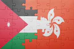 Puzzle with the national flag of hong kong and jordan Stock Photo