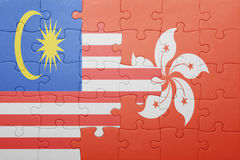 Puzzle with the national flag of hong kong and malaysia. Concept Stock Image