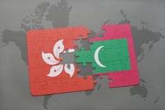 Puzzle with the national flag of hong kong and maldives on a world map background. 3D illustration Stock Photography