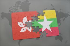 Puzzle with the national flag of hong kong and myanmar on a world map background. 3D illustration Royalty Free Stock Images