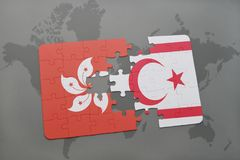 Puzzle with the national flag of hong kong and northern cyprus on a world map background. Royalty Free Stock Photography