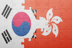 Puzzle with the national flag of hong kong and south korea. Concept royalty free stock image
