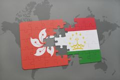 Puzzle with the national flag of hong kong and tajikistan on a world map background. 3D illustration Royalty Free Stock Photo
