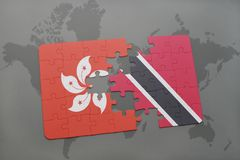 Puzzle with the national flag of hong kong and trinidad and tobago on a world map background. 3D illustration Stock Images