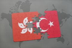 Puzzle with the national flag of hong kong and turkey on a world map background. 3D illustration Royalty Free Stock Photography