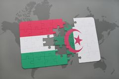 Puzzle with the national flag of hungary and algeria on a world map Stock Image