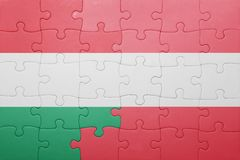 Puzzle with the national flag of hungary and austria. Concept Stock Image