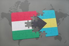 Puzzle with the national flag of hungary and bahamas on a world map Stock Photography
