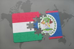 Puzzle with the national flag of hungary and belize on a world map Royalty Free Stock Photos