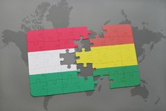 Puzzle with the national flag of hungary and bolivia on a world map Stock Photography