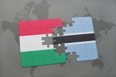 Puzzle with the national flag of hungary and botswana on a world map Royalty Free Stock Photography