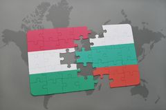 Puzzle with the national flag of hungary and bulgaria on a world map background. 3D illustration Stock Photo
