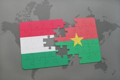 Puzzle with the national flag of hungary and burkina faso on a world map Stock Image