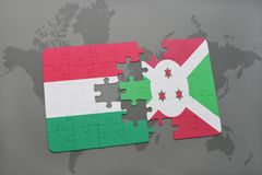 Puzzle with the national flag of hungary and burundi on a world map Royalty Free Stock Images