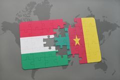 Puzzle with the national flag of hungary and cameroon on a world map Stock Photo