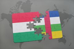 Puzzle with the national flag of hungary and central african republic on a world map Royalty Free Stock Photos