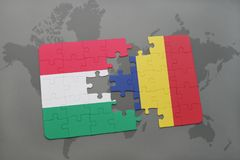 Puzzle with the national flag of hungary and chad on a world map Stock Image