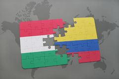 Puzzle with the national flag of hungary and colombia on a world map Royalty Free Stock Images